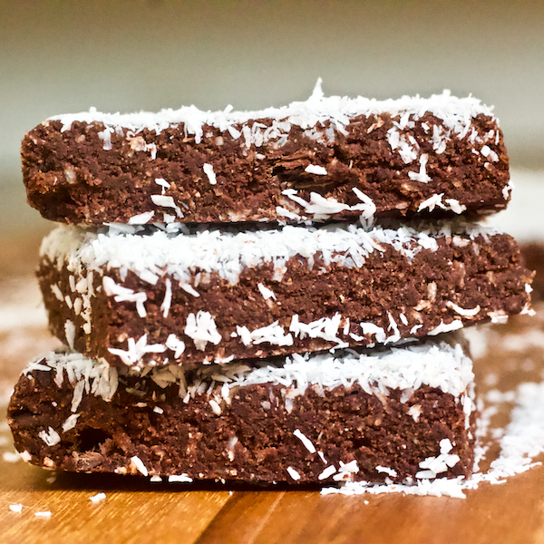 Chocolate Banana Coconut Fudge Bars | Chocolate, banana, and coconut come together in these deliciously decadent fudge bars. These no-bake treats are easy to make, naturally vegan, gluten-free, and have no added sugar. A perfect dessert or healthy, sweet snack!