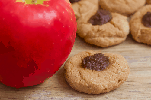 Apple Pie Thumbprint Cookies | Soft, doughy thumbprint cookies with a heavenly apple cinnamon scent and taste! Vegan, gluten-free, and only sweetened with fruit. These cookies are like bite-sized apple pies!