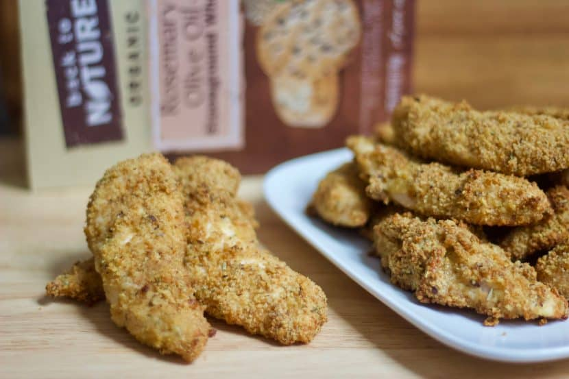 Rosemary & Olive Oil Cracker Crusted Chicken Fingers | Healthy Helper @Healthy_Helper A grownup, healthy version of your favorite childhood meal! These baked chicken fingers are full of flavor from the rosemary, stoneground wheat crackers, olive oil, and cheese blend they are coated with. Crispy on the outside, moist on the inside, and totally delicious!