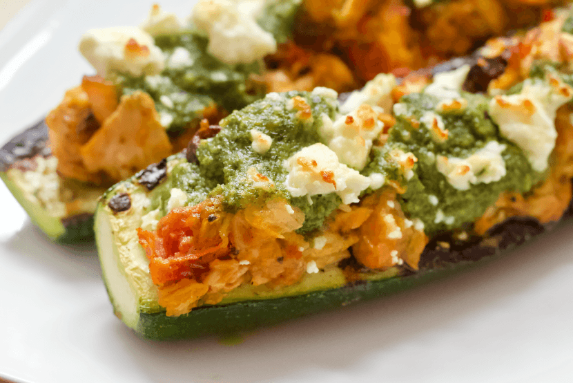 Grilled Mediterranean Zucchini Boats   Summertime means it's grilling season! Fire up the grill and escape to a mediterranean oasis with these Grilled Mediterranean Zucchini Boats. Stuffed with humus, olives, roasted tomatoes, and cedar plank salmon....they are a taste and texture delight!