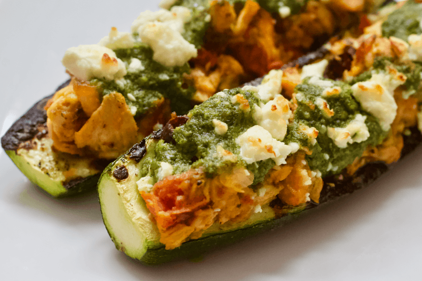 Grilled Mediterranean Zucchini Boats | Summertime means it's grilling season! Fire up the grill and escape to a mediterranean oasis with these Grilled Mediterranean Zucchini Boats. Stuffed with humus, olives, roasted tomatoes, and cedar plank salmon....they are a taste and texture delight!