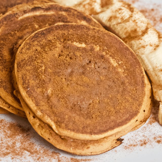 Chocolate Pumpkin Protein Pancakes | Soft n' fluffy pancakes made with high fiber pumpkin puree, chocolate protein powder, and 10 grain pancake mix! A healthy, filling alternative to traditional pancakes and perfect for satisfying a sweet tooth...no syrup needed.